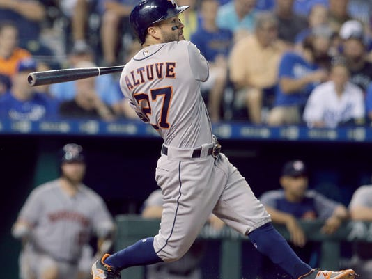 Houston Astros' Jose Altuve watches his two-run home run during the ninth inning of the team's baseball game against the Kansas City Royals on Thursday, June 8, 2017, in Kansas City, Mo. (AP Photo/Charlie Riedel)