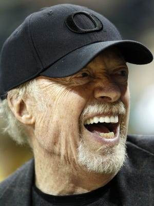 Nike founder Phil Knight smiles during the first half of an NCAA college basketball game between Oregon and Stanford on Jan. 5, 2012, in Eugene.