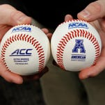 A view of the new baseball (L) being used by the NCAA  next to last years ball (R) during a media day press conference at the University of Louisville in Louisville, Kentucky. The new ball has smaller stitching making the ball more aerodynamic.            February 9, 2015