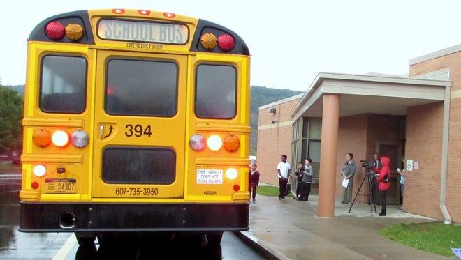 A school bus pulls up in front of T.K. Beecher Elementary School in Elmira on Wednesday morning.