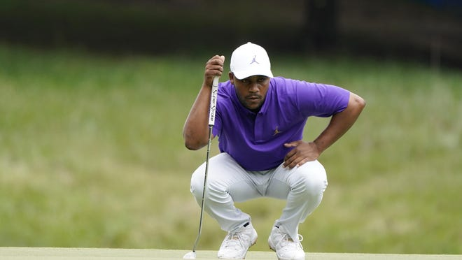 Harold Varner III lines a putt on the first green during the final round of the Wyndham Championship golf tournament at Sedgefield Country Club on Sunday, Aug. 16, 2020, in Greensboro, N.C.