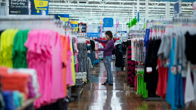 Chelsea Vick shops for clothes at Wal-Mart Supercenter in Rogers, Ark., in June.