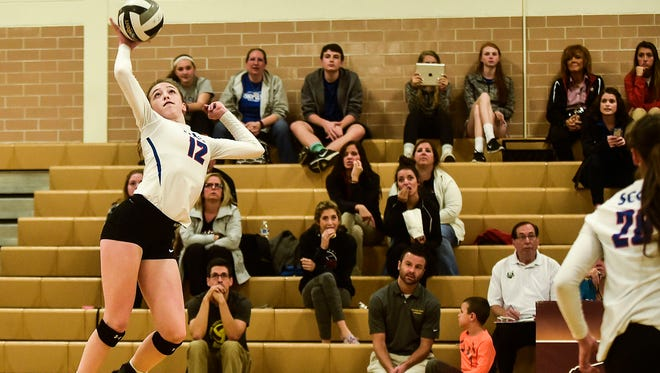 Highland's Raina Terry takes to the air during the Division III district semifinal volleyball match at Buckeye Valley. Terry is one of the area's top returnees for 2017.