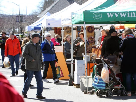People enjoy the weekly Pleasantville Farmers Market in Memorial Plaza in Pleasantville April 8, 2017.