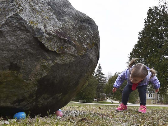 Lily Baudhuin of Germantown found some Easter eggs under a rock during last year's hunt at Fitzgerald Park in Ellison Bay.