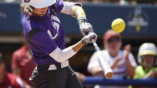 LSU's Amber Serrett hits the ball to get on base during a Women's College World Series softball game against Alabama in Oklahoma City, Saturday.