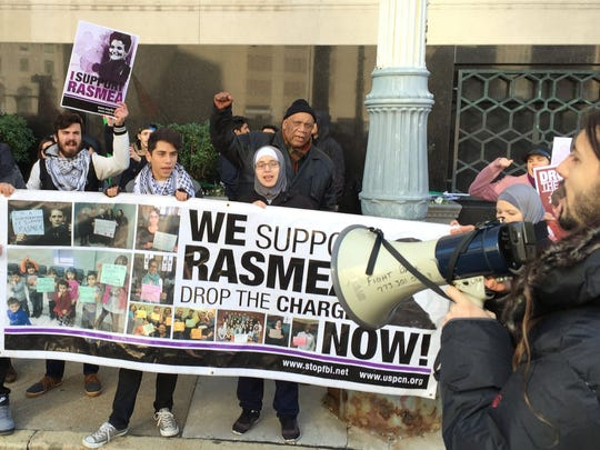 Supporters of Rasmieh Odeh, 67, rally outside of Federal Court in Detroit after Odeh was found guilty, Monday, Nov. 10, 2014, of not disclosing that she had been convicted in a 1969 Israel bombing when she was applying for U.S. citizenship. Diane Weiss/Detroit Free Pres