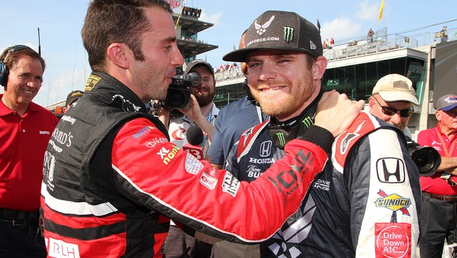 An emotional Dale Coyne Racing IndyCar driver Conor Daly (17) is hugged by James Davison (33) as they both just made the field of 33 cars on qualification day for the Indianapolis 500 at the Indianapolis Motor Speedway on Saturday, May 19, 2018.