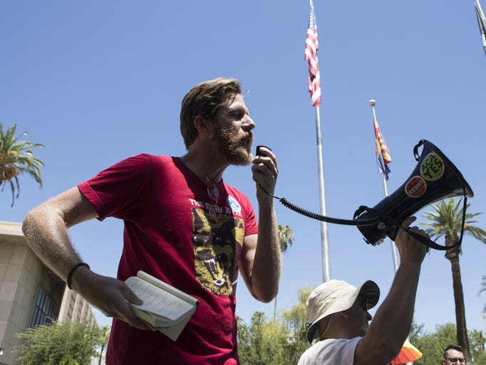 Chris Hanlon speaks at a rally in support of the Save