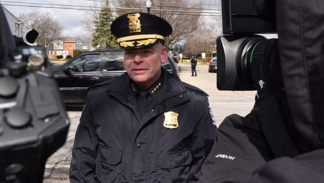 Novi Police Chief David Molloy speaks to members of the media after an armed man surrendered to police Thursday afternoon.