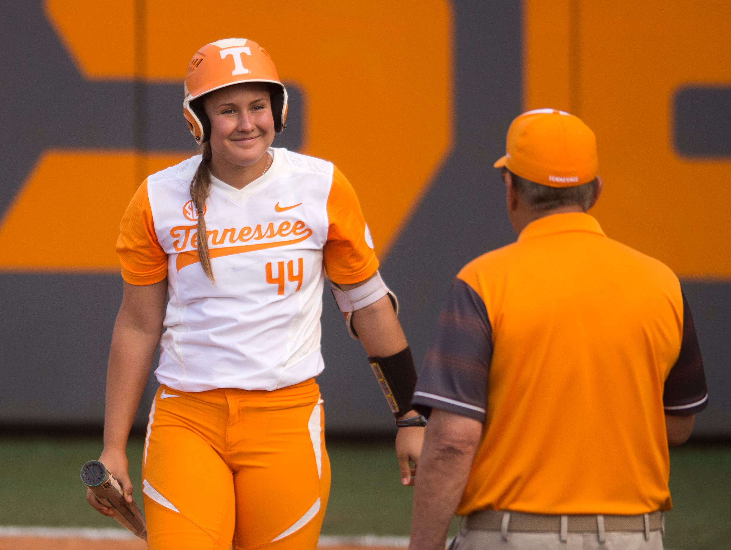 Tennessee's Abby Lockman (44) smiles as she walks over to Tennessee Softball Head Coach Ralph Weekly during an NCAA Super Regional game between Tennessee and Texas A&M at Sherri Parker Lee Stadium on Friday, May 26, 2017.