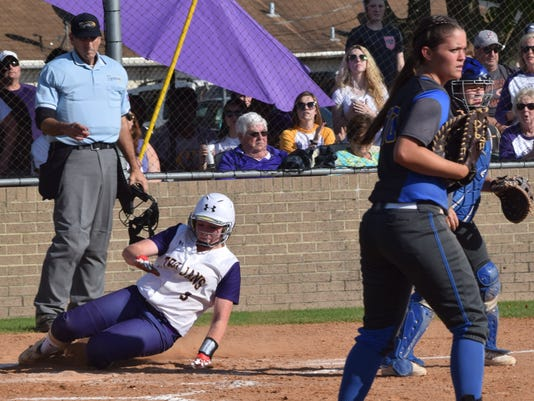 ASH's Briahna Bennett (3, left) is safe after sliding into home against East Ascension in a Friday home playoff game.