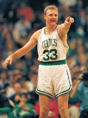 Boston Celtics forward Larry Bird compliments a teammate for a nice pass at Boston Garden in March of 1992.