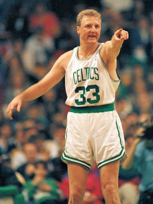 Boston Celtics forward Larry Bird compliments a teammate for a nice pass after Bird scored during first half NBA action at Boston Garden on Sunday, March 1, 1992, against the Dallas Mavericks.