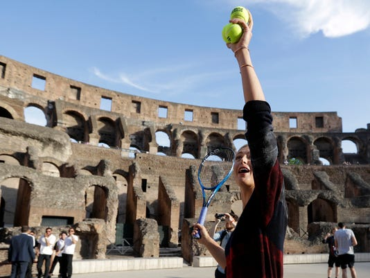 Russia's Maria Sharapova looks up during an exhibition at the Rome ancient Colosseum ahead of the Italian Open tennis tournament, Sunday, May 14, 2017. (AP Photo/Gregorio Borgia)