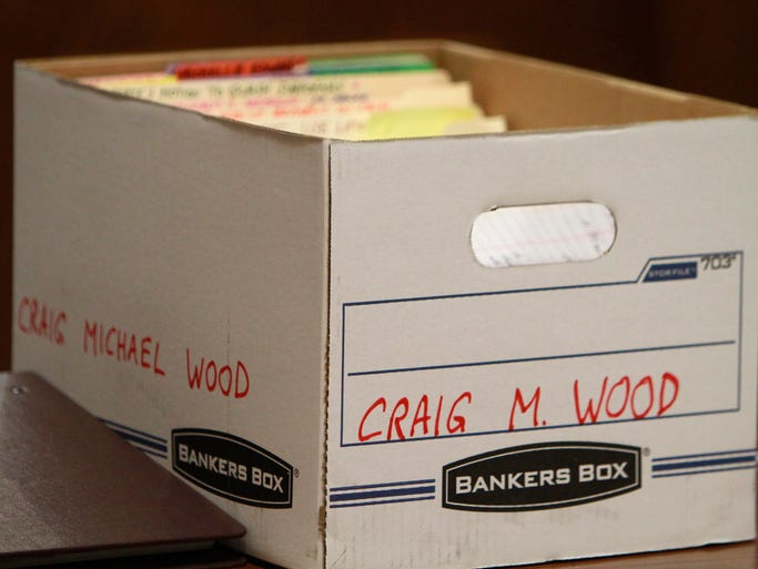 A box containing documents sits on the defense's table during a preliminary hearing for Crag Michael Wood on Thursday, May 22, 2014. Wood is accused of kidnapping, raping and killing 10-year-old Hailey Owens.