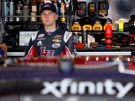 William Byron waits in the garage area during practice