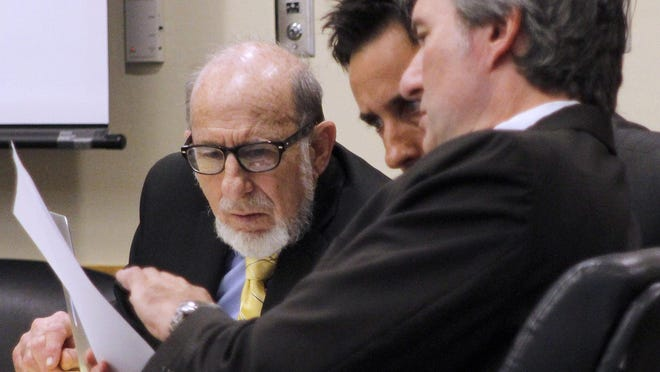 Michael Spiegel talks to his attorneys while on trial for the murders of his ex-wife and her fiance. Spiegel's attorneys plead guilty, citing an insanity defense. The trial continues Thursday