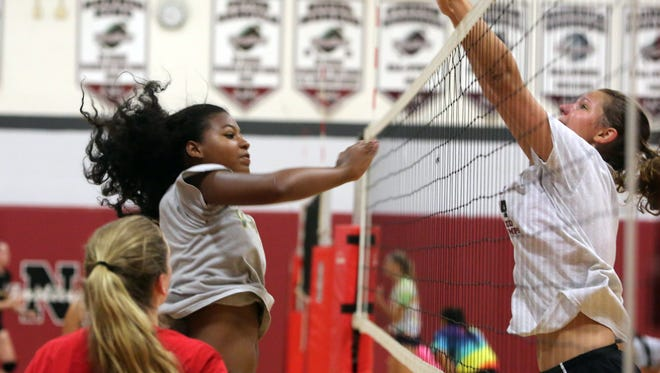 Aria Jordan, left, practices with her Nyack High School volleyball team at the school, Aug. 21, 2015.