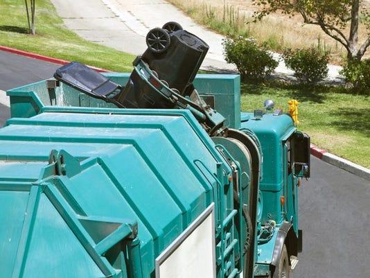 robotic-arm-trash-truck-dumps-a-large-black-can_large.jpg