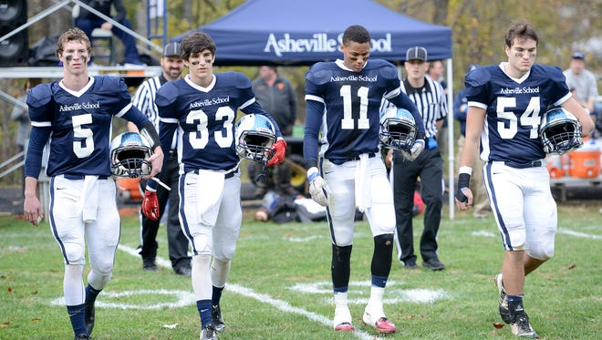 Asheville School's captains for an Oct.. 31 home game against Christ School. The Blues have been fined a total of $750 and barred from the 2016 state playoffs after forfeiting a Nov. 6 playoff game against the Greenies.