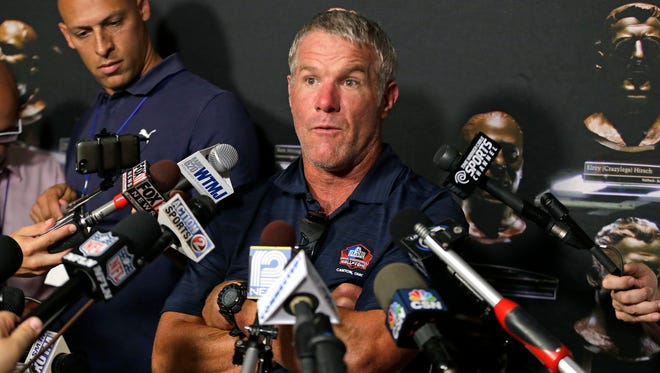 Brett Favre  talks  with the media about his induction into the Hall of Fame as well as his career, his drive, and the players and coaches with whom he played during a news conference Friday, Aug. 5, 2016 in Canton, Ohio, where Favre is part of the  NFL Hall of Fame Class of 2016.