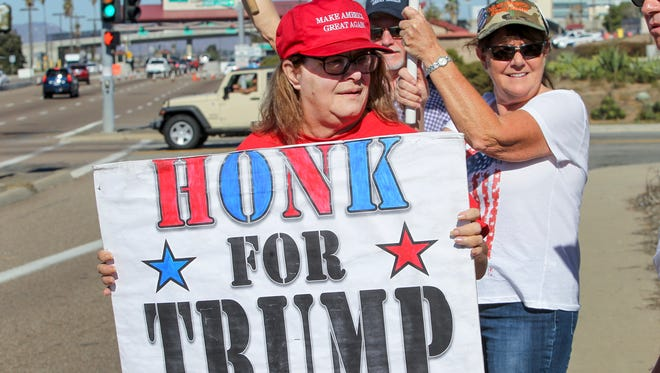 Mari Hayden joins supporters of President-elect Donald Trump in front of Marine Corps Base Camp Pendleton in Oceanside, Calif., on Nov. 11.