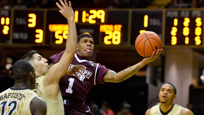 Mississippi State Bulldogs guard Lamar Peters (1) shoots against Vanderbilt Commodores guard Nolan Cressler (24) during the second half at Memorial Gymnasium. Vanderbilt won 77-48.