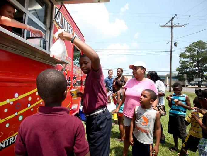 Kona Ice and Slider Central trucks made a stop at Liller Maddox Marbles Community Center on Wednesday, Aug. 6 to distribute free snow cones and gourmet slider combos. Company representatives said it was a fun way to give back to the community.