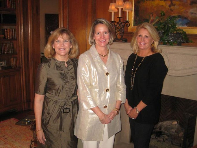Co-chairs Julie Walker, left, and Amy Colton with hostess Meg Turner at the Swan Ball 2013 Kickoff at the Turner home.