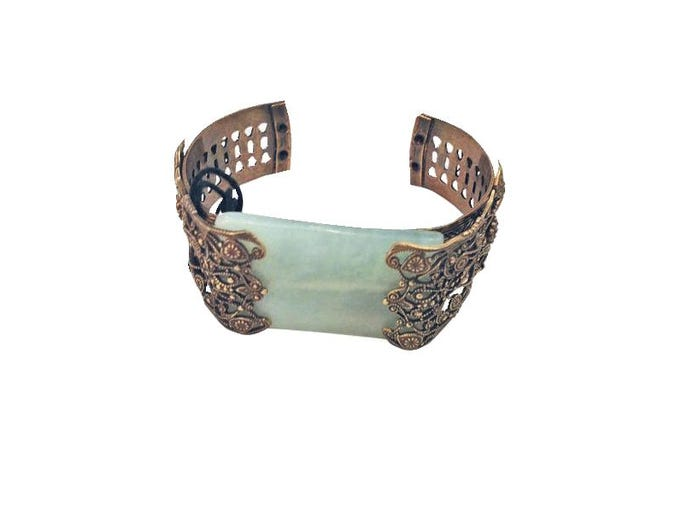 This has a vintage vibe with filigree and brass mixed with milky jade. But it works with all the summer boho pieces you own. $95 at Johnny Q, 317 Main St. in Franklin, 615-794-2763.