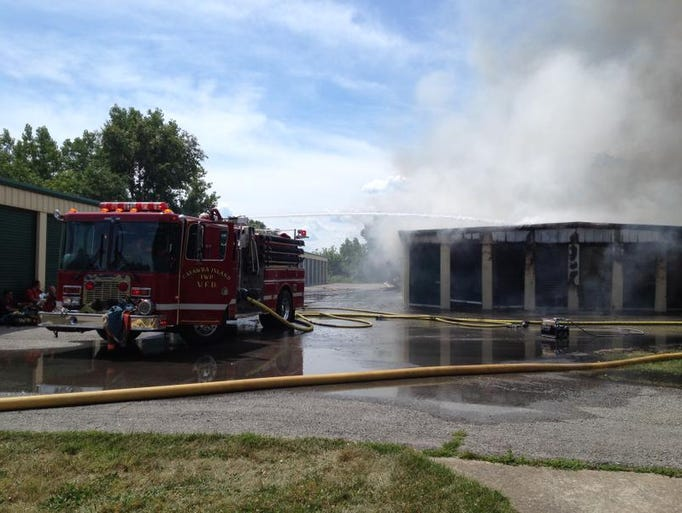Four fire departments worked to extinguish a blaze at Lakeside-Marblehead Storage on East Harbor Road on Friday, July 18, 2014.