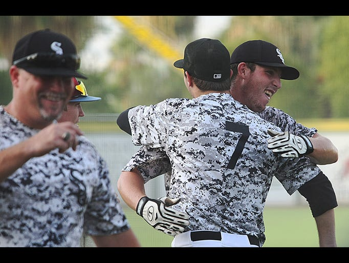 Jacob Worrell of the OCCL White Sox, celebrates his win in the home run contest during the 2014 SCCBL/OCCL All Star game played at Palm Springs Stadium Saturday, July 26, 2014.