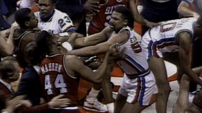 The Sixers' Rick Mahorn, 44, and the Pistons' James Edwards shove each other during the teams' brawl in April 1990 at The Palace of Auburn Hills.