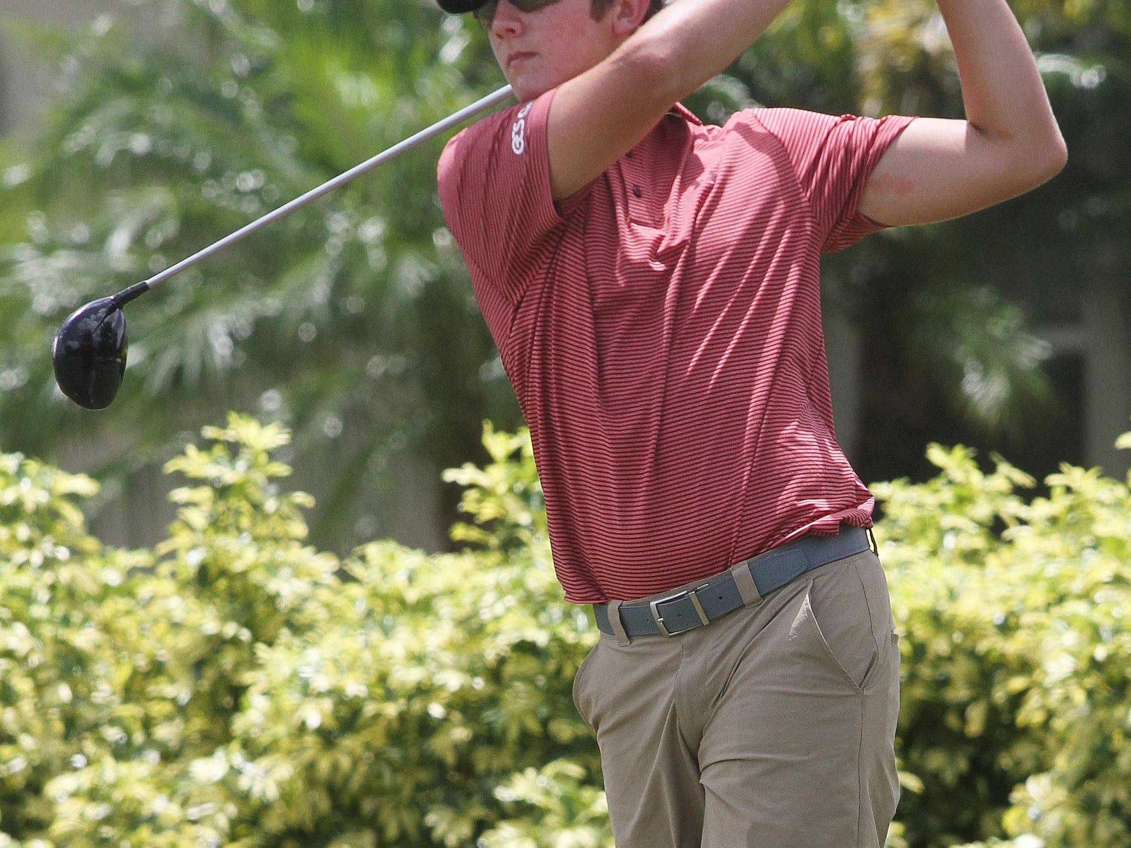 ECS golfer Shane Reynolds tees off on the 2nd hole while practicing at the Verandah Golf Club on Saturday.