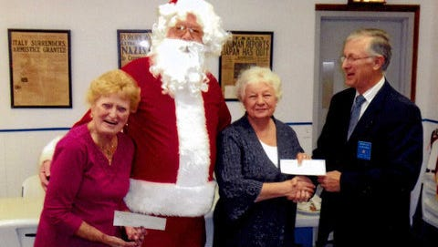 Left to right : Mary Welch; Santa Claus;Judy Perkins; Charlie Duschen-President of Kiwanis