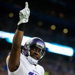 Dec 14, 2014; Detroit, MI, USA; Minnesota Vikings wide receiver Greg Jennings (15) celebrates his touchdown during the second quarter against the Detroit Lions at Ford Field. Mandatory Credit: Tim Fuller-USA TODAY Sports