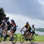 Pairs of riders make their way north along the Natchez-Trace Parkway Sunday morning on the first leg of a 40-mile lap of the Ross Barnett Reservoir.  The ride is a part of the weekend-long Ridgeland One Behind The Other (OBO) Tandem Rally which drew twenty-seven participating couples from 10 states.