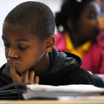 Alphonso Mingo works to solve a math problem at Hawkins Elementary School.