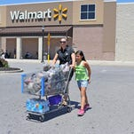 Shoppers such as Vineland residents Jacqueline Mass and Juleysy M. Lopez, 10, will have to shop before midnight at Walmart after this Sunday. That's when the store will start closing at midnight to reopen at 6 a.m.