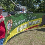 """(L to R) Vietnam Veteran Tom Farrell, Fred Irons of Delran, and Vietnam Veteran Bob Gilbert stand outside of Delran VFW Post 3020 with a """"Welcome Home Vietnam Veterans"""" sign. The sign will be used in a parade they are sponsoring on the 50th anniversary of the beginning of the Vietnam War on Sept. 12th to honor the Vietnam veterans and give them the welcome home and thanks they never received when they came home from the war. Friday, August 28, 2015"""