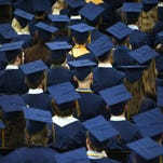Graduates listen to the program during the Essex High School commencement on June 13.