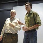 Rothko (Daniel Gray) and Ken (Bo Smith) examine a painting.