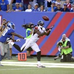 Atlanta Falcons wide receiver Julio Jones makes a catch near the end zone as New York Giants cornerback Prince Amukamara defends during the second half Sunday in East Rutherford, New Jersey.