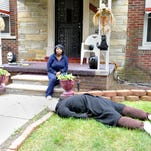 A Detroit woman's front yard decor has prompted repeated visits by police.
