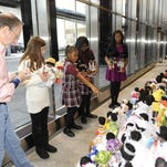 Neal Rubin, left, Victoria Pomeroy, Mickenzy Crowder, Micaelah Crowder and Jayla Forest rank the dolls.
