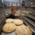 Red Eagle Produce & ice Cream staff, Danielle Furfari shows fresh baked pies ready to be pack for the Holiday sale at their store in Woodbury.