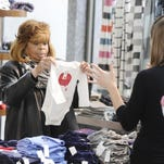 Paulette Kane looks over some onesies while shopping at Somerset Collection CityLoft at 1001 Woodward in Detroit