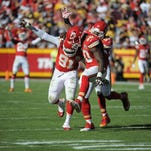 From left, Chiefs defenders Tamba Hali, Justin Houston and Derrick Johnson have been key to the team's 4-game win streak.