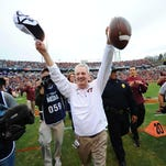 Virginia Tech Hokies head coach Frank Beamer reacts to the crowd after defeating the Virginia Cavaliers 23-20 at Scott Stadium on Nov. 28.